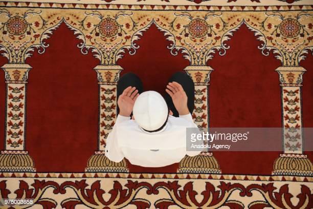 A muslim performs Eid alFitr prayer at Somuncu Baba Complex in Malatya Turkey on June 15 2018 Eid alFitr is a religious holiday celebrated by Muslims...