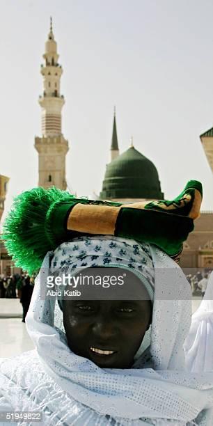 Muslim pilgramge woman walks in front of the Prophet Mohammed Mosque January 13 2005 in Medina Saudi Arabia Pilgrams began arriving in Saudi Arabia...