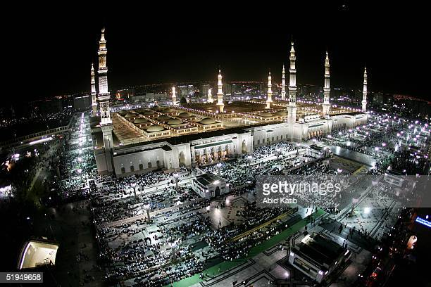 Muslim pilgramges pray the AlEsha'a prayer in the Prophet Mohammed Mosque January 13 2005 in Medina Saudi Arabia Pilgrams began arriving in Saudi...