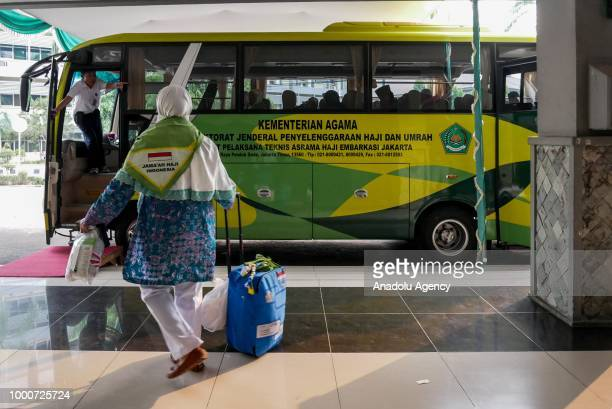 A muslim pilgrim arrives to enter the hajj bus at Hajj boarding house Pondok Gede in Jakarta Indonesia on July 17 2018