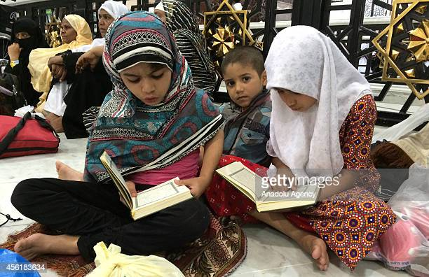 Muslim pilgrim children gathering for the annual Hajj pilgrimage read Quran at the prayer hall near Masjid alHaram in the Muslim holy city of Mecca...