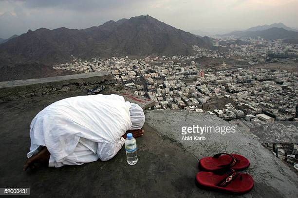 Muslim Pilgrim girl prays on Jebel alNoor or Mount of Light 6 kms from Mecca where they will visit Ghar Heera or Heera cave January 16 2005 as part...