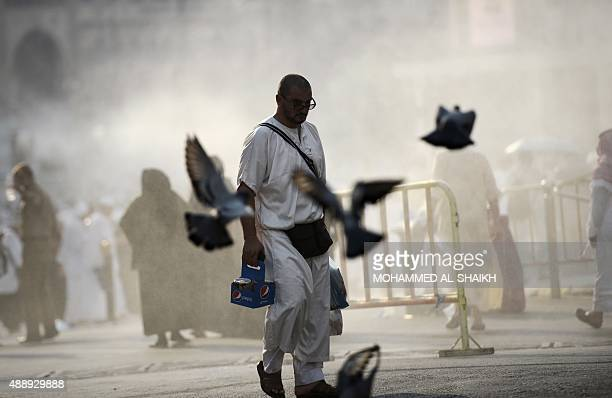 A Muslim pilgrim leaves after the Asr afternoon prayer at Mecca's Grand Mosque on September 18 2015 More than 12 million foreign Muslims have poured...