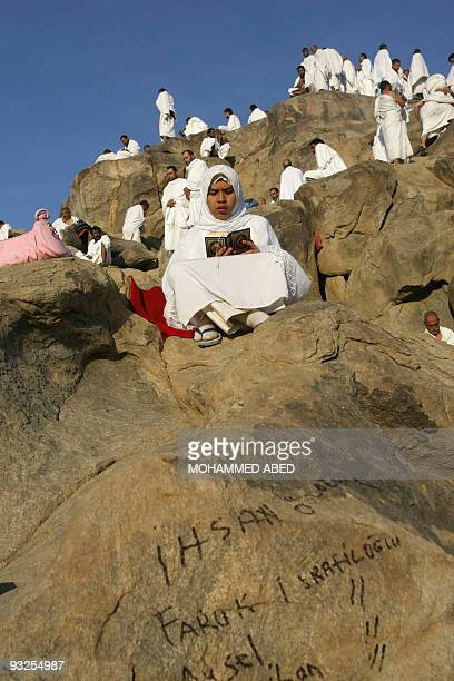A Muslim pilgrim prays at AlRahma mountain in the Saudi holy city of Mecca 29 December 2006 Around two million Muslim faithful headed yesterday from...