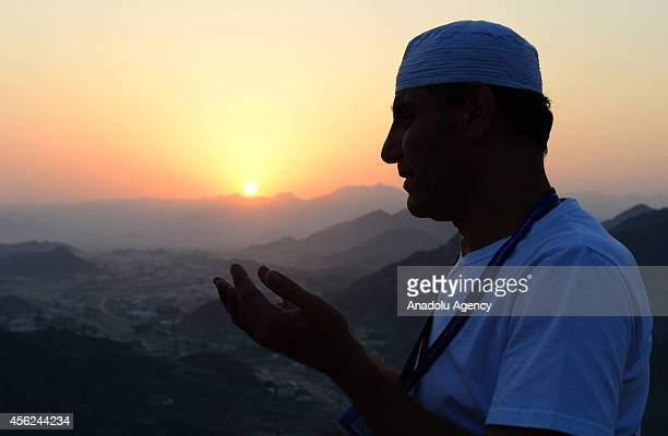 Muslim pilgrim prays at the top of al Nour mountain near Hira cave where Prophet Muhammad received the first revelation of the Quran on September 28...