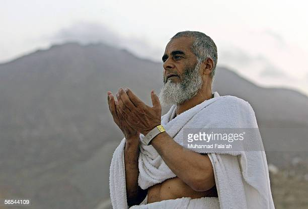Muslim pilgrim prays on the Mount of Mercy on January 9 2006 in Arafat outside the holy city of Mecca in Saudi Arabia Muslim pilgrims have journeyed...