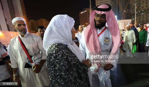 A Muslim pilgrim speaks to a translator in the Saudi holy city of Mecca ahead of the start of the Hajj pilgrimage on August 17 2018 The sixday Hajj...