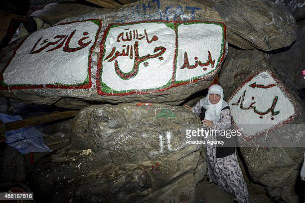 Muslim pilgrim stands at entrance of the Hira Cave at the top of the Jabal alNour ahead of the start of the annual Hajj pilgrimage in Mecca Saudi...