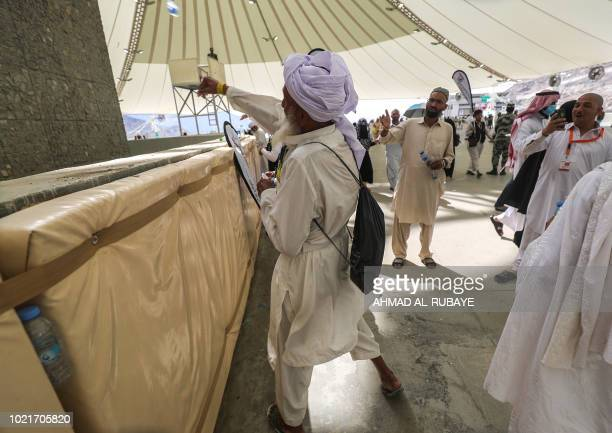 A Muslim pilgrim takes part in the symbolic stoning of the devil at the Jamarat Bridge in Mina near Mecca which marks the final major rite of the...