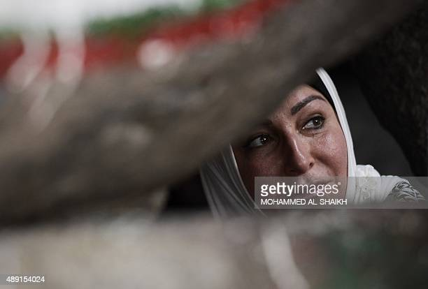 A Muslim pilgrim visits the Hiraa cave on Noor mountain on September 19 2015 as more than a million Muslims from around the world converge the holy...
