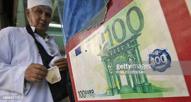 A Muslim pilgrim waits in line to exchange his money in the Saudi holy city of Mecca on December 3 2008 Hundreds of thousands of Muslims from all...