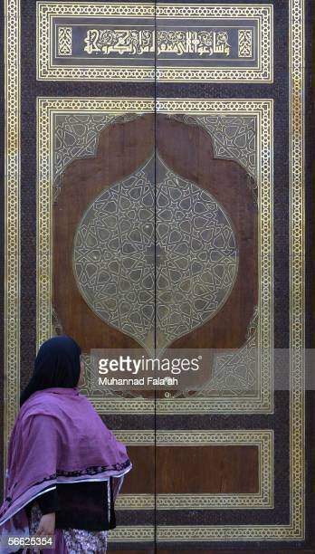 Muslim pilgrim walks in front of a gate to Qiba mosque the first mosque built in Islam on January 19 2006 in the holy city of Medina Saudi Arabia...