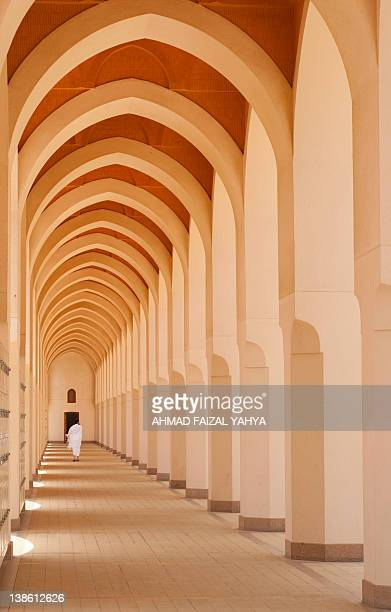 Muslim pilgrim walks in hallway in Al Madinah
