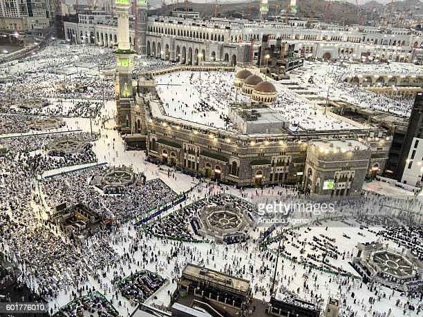 Muslim pilgrims are seen near the Kaaba Islam's holiest site located in the center of the Masjid alHaram in Mecca Saudi Arabia on September 10 2016