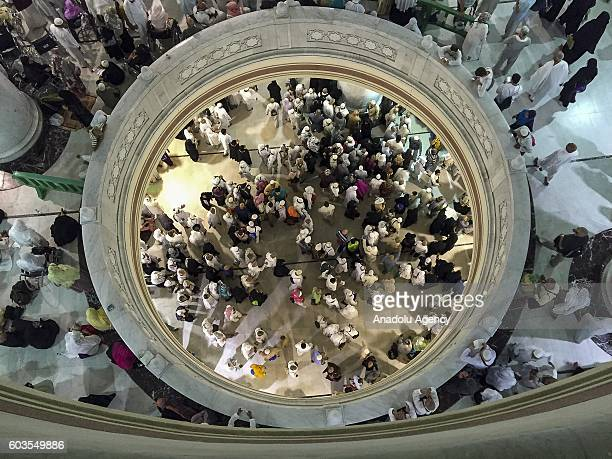 Muslim pilgrims are seen near the Kaaba Islam's holiest site located in the center of the Masjid alHaram during Hajj in Mecca Saudi Arabia on...