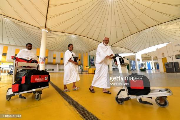 Muslim pilgrims arrive at King Abdulaziz International Airport on July 7 prior to the annual Hajj pilgrimage in the holy city of Mecca The Hajj...