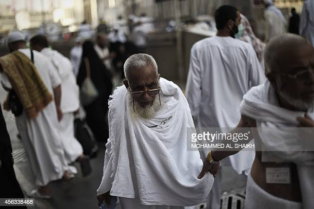 Muslim pilgrims arrive for a prayer at Mecca's Grand Mosque home of the cubeshaped Kaaba or 'House of God' that Muslims believe was built by Abraham...