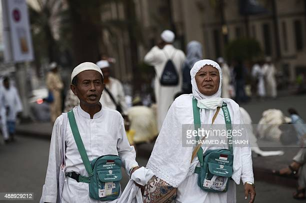 Muslim pilgrims arrive for the Maghrib late afternoon prayer at Mecca's Grand Mosque on September 18 2015 More than 12 million foreign Muslims have...