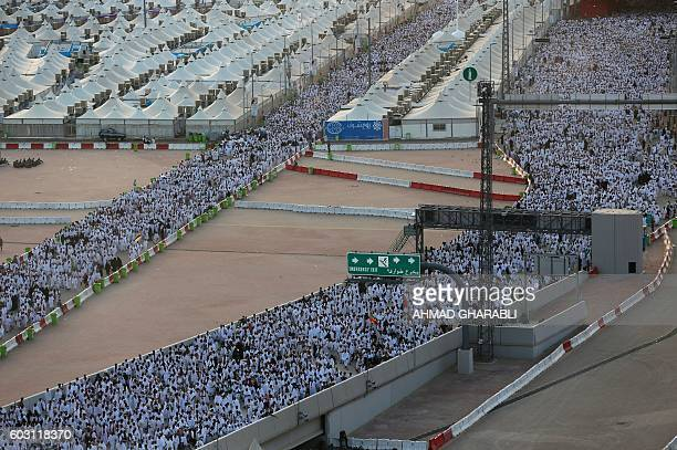 Muslim pilgrims arrive to throw pebbles at pillars during the 'Jamarat' ritual the stoning of Satan in Mina near the holy city of Mecca on September...