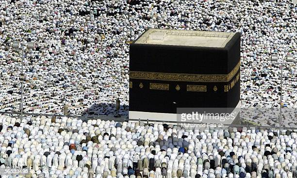 Muslim pilgrims attend Friday prayer on January 6, 2006 in the city of Mecca, Saudi Arabia. At least 50 were killed and many more injured when a...