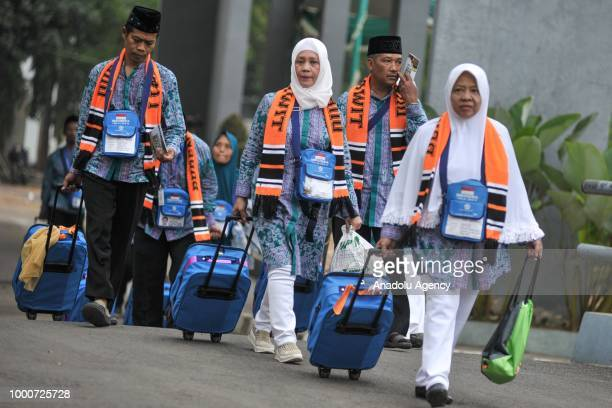 Muslim pilgrims carry their belongings before departing to the holy city of Mecca at Hajj boarding house Pondok Gede in Jakarta Indonesia on July 17...