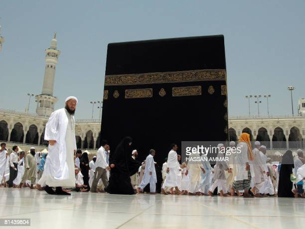 Muslim pilgrims circumambulate around the Kaaba inside Mecca's Grand Mosque Islam's holiest shrine during their off season pilgrimage known as Omra...