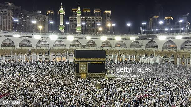 Muslim pilgrims circumambulate around the Kaaba Islam's holiest site located in the center of the Masjid alHaram during Hajj in Mecca Saudi Arabia on...