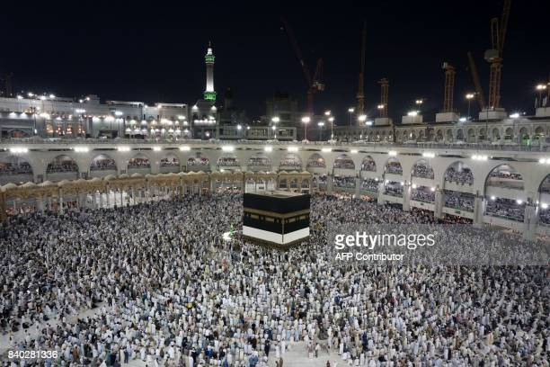Muslim pilgrims circumambulate around the Kaaba the cubic building at the Grand Mosque ahead of the annual Hajj pilgrimage in the Muslim holy city of...