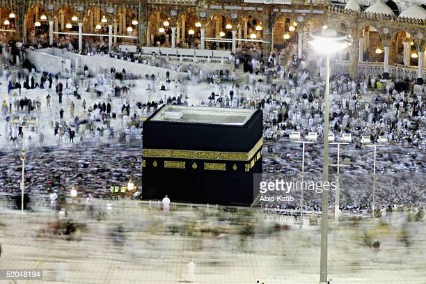 Muslim pilgrims circumambulate as others perform the last prayer around the holy Kaaba at Mecca's Grand Mosque to finish the annual hajj rituals...