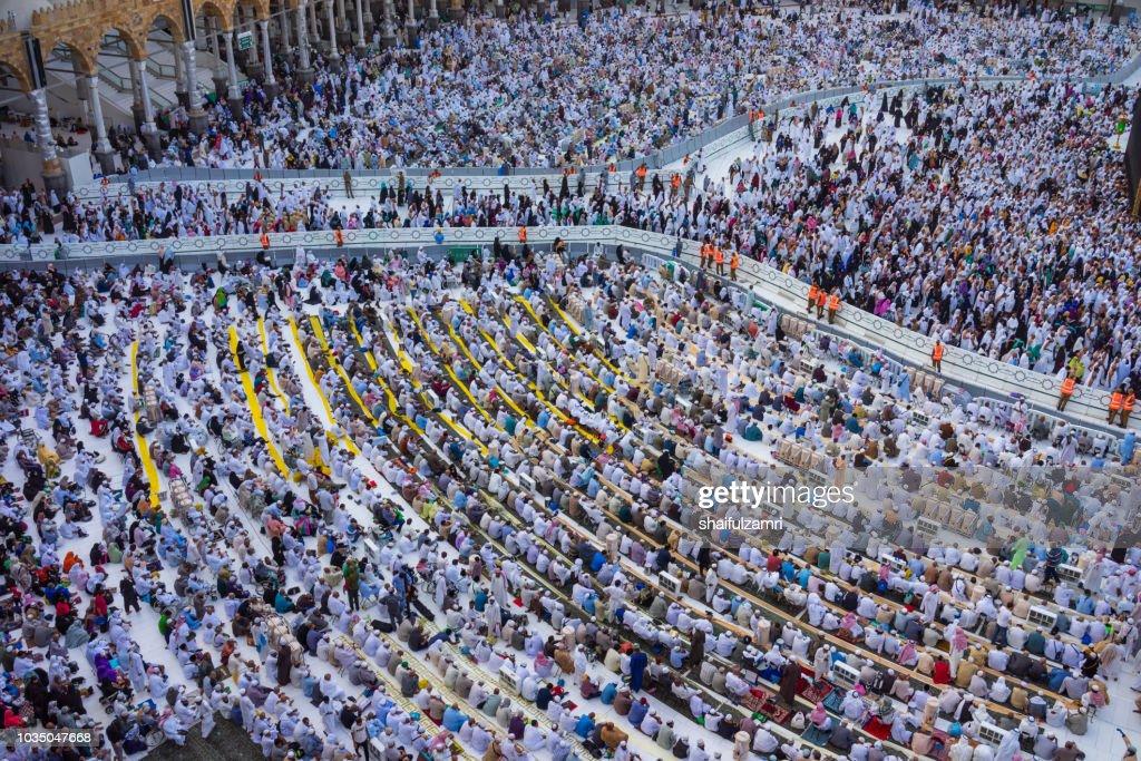 Muslim pilgrims circumambulate or 'tawaf' the Kaabah after Asar prayer at Masjidil Haram, Makkah, Saudi Arabia. : Stock Photo