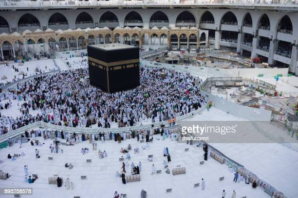 "Muslim pilgrims circumambulate or ""tawaf"" the Kaabah after Subuh Prayer at Masjidil Haram"