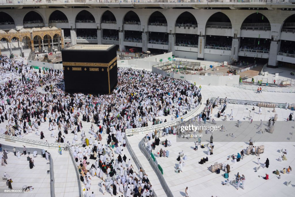 "Muslim pilgrims circumambulate or ""tawaf"" the Kaabah after Subuh Prayer at Masjidil Haram : Stock Photo"