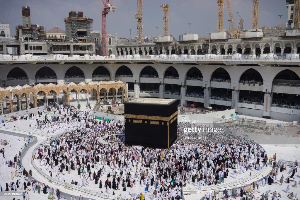 "Muslim pilgrims circumambulate or ""tawaf"" the Kaabah after Subuh Prayer at Masjidil Haram : Stock Photo"