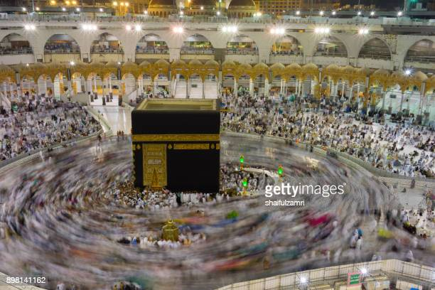 Muslim pilgrims circumambulate or 'tawaf' the Kaabah after Subuh prayer at Masjidil Haram