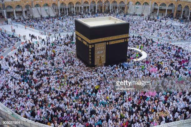 "muslim pilgrims circumambulate or ""tawaf"" the kaabah after subuh prayer at masjidil haram, makkah, saudi arabia. - eid ul fitr photos stock pictures, royalty-free photos & images"