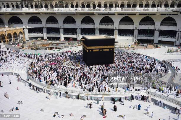 "muslim pilgrims circumambulate or ""tawaf"" the kaabah after subuh prayer at masjidil haram, makkah, saudi arabia. - pilgrimage stock pictures, royalty-free photos & images"
