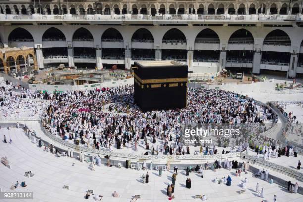 "muslim pilgrims circumambulate or ""tawaf"" the kaabah after subuh prayer at masjidil haram, makkah, saudi arabia. - shaifulzamri stock pictures, royalty-free photos & images"