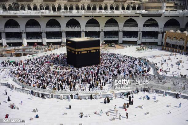 "muslim pilgrims circumambulate or ""tawaf"" the kaabah after subuh prayer at masjidil haram, makkah, saudi arabia. - kaaba stock pictures, royalty-free photos & images"