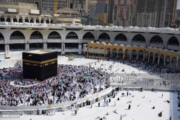 "muslim pilgrims circumambulate or ""tawaf"" the kaabah after subuh prayer at masjidil haram, makkah, saudi arabia. - kaaba fotografías e imágenes de stock"