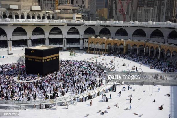 """muslim pilgrims circumambulate or """"tawaf"""" the kaabah after subuh prayer at masjidil haram, makkah, saudi arabia. - kaaba photos et images de collection"""