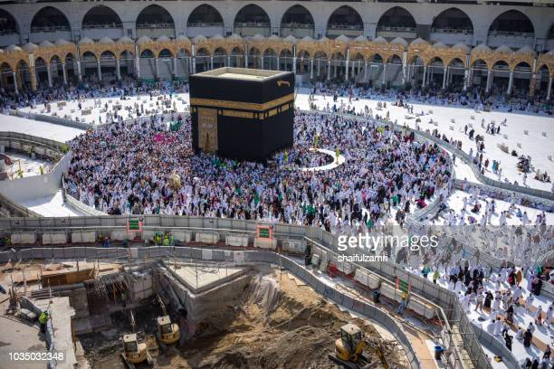 "muslim pilgrims circumambulate or ""tawaf"" the kaabah after zuhur prayer at masjidil haram, makkah, saudi arabia. - {{asset.href}} stock pictures, royalty-free photos & images"