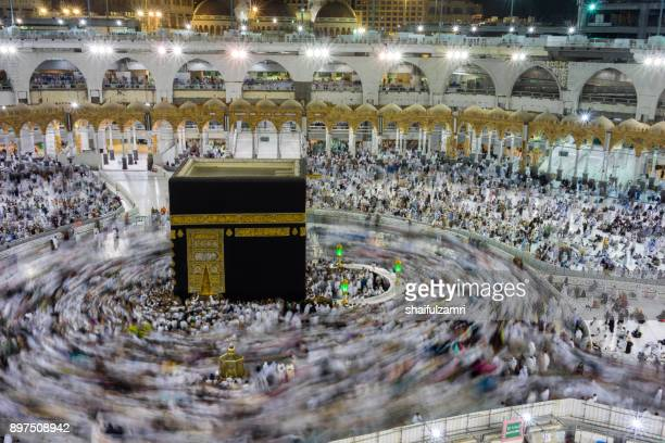 "muslim pilgrims circumambulate or ""tawaf"" the kaabah - shaifulzamri stock pictures, royalty-free photos & images"