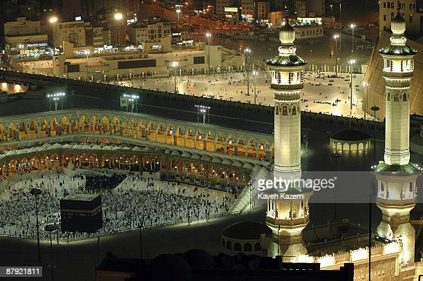 Muslim pilgrims circumambulate the Kaaba at the Masjid alHaram in the holy city of Mecca Saudi Arabia 28th November 2005 The faithful circle seven...
