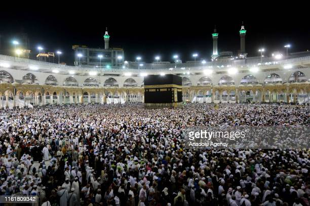 Muslim pilgrims circumambulate the Kaaba, Islam's holiest site, located in the center of the Masjid al-Haram, Saudi Arabia on August 14 after stoning...