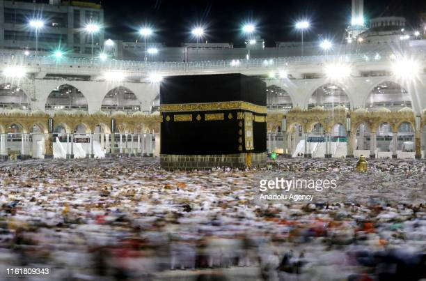 Muslim pilgrims circumambulate the Kaaba Islam's holiest site located in the center of the Masjid alHaram Saudi Arabia on August 14 after stoning the...