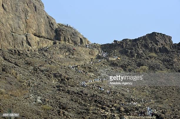 Muslim pilgrims climb the Jabal alNour to visit Hira Cave ahead of the start of the annual Hajj pilgrimage in Mecca Saudi Arabia on September 14 2015...