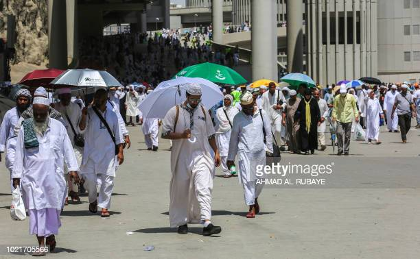 Muslim pilgrims depart after throwing the final pebbles in the symbolic stoning of the devil at the Jamarat Bridge in Mina near Mecca which marks the...