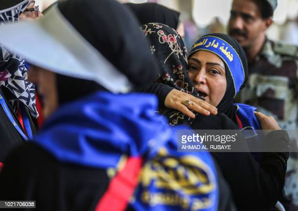 Muslim pilgrims embrace each other after having taken part in the symbolic stoning of the devil at the Jamarat Bridge in Mina near Mecca which marks...