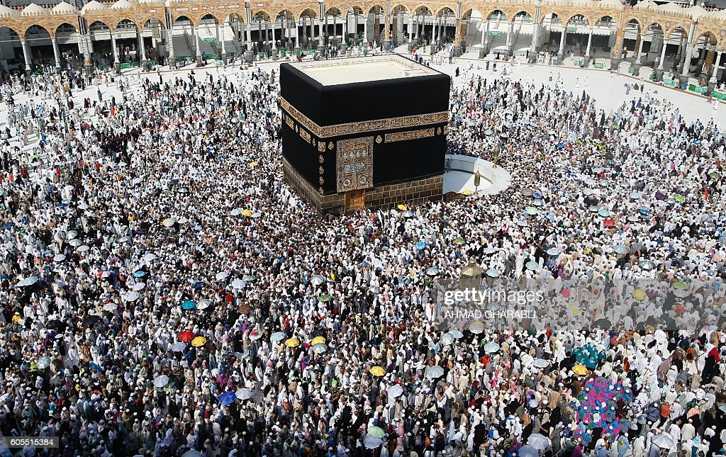 Muslim pilgrims from all around the world circle around the Kaaba at the Grand Mosque, in the Saudi city of Mecca on September 14, 2016. More than 1.8 million faithful from around the world have been attending the annual pilgrimage which officially ends on September 15. / AFP / AHMAD