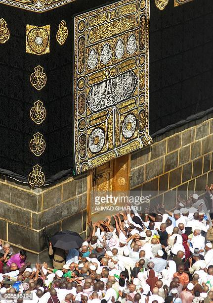 Muslim pilgrims from all around the world circle around the Kaaba at the Grand Mosque in the Saudi city of Mecca on September 14 2016 More than 18...